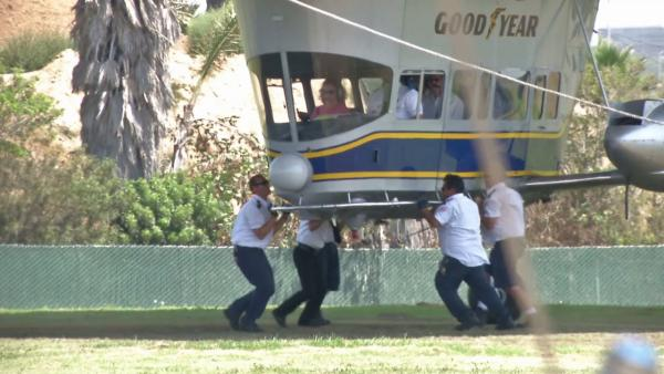 A crew pushes off the Goodyear Blimp during takeoff in this photo. ABC7 anchor Phillip Palmer got a chance to ride the iconic blimp, which is steeped in history reaching back to the 1930s when Goodyear built airships for the Navy.