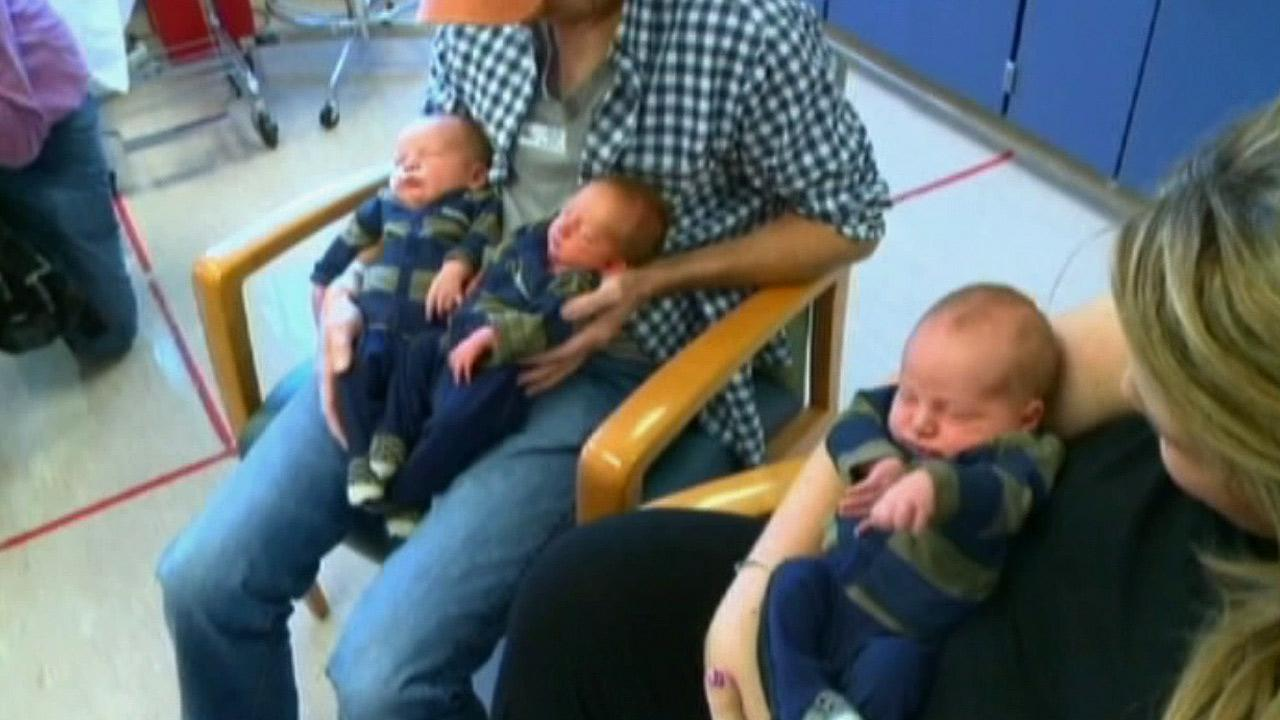 Brittany Deen and her triplets are shown in this photo. The boys may set a Guinness World Record for their total weight.