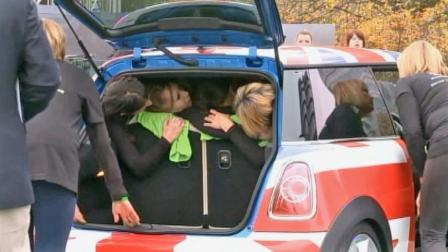 Twenty-eight women crammed into a Mini Cooper, setting a new Guinness World Record.