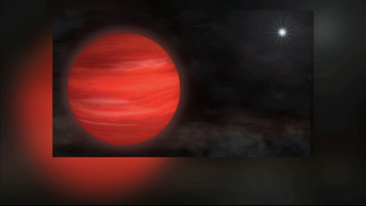 The super-Jupiter Kappa Andromedae b, shown here in an artists rendering, circles its star at nearly twice the distance that Neptune orbits the sun.