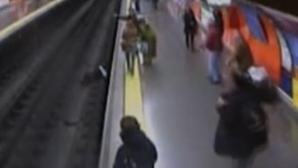 Woman faints, falls on train tracks in Madrid