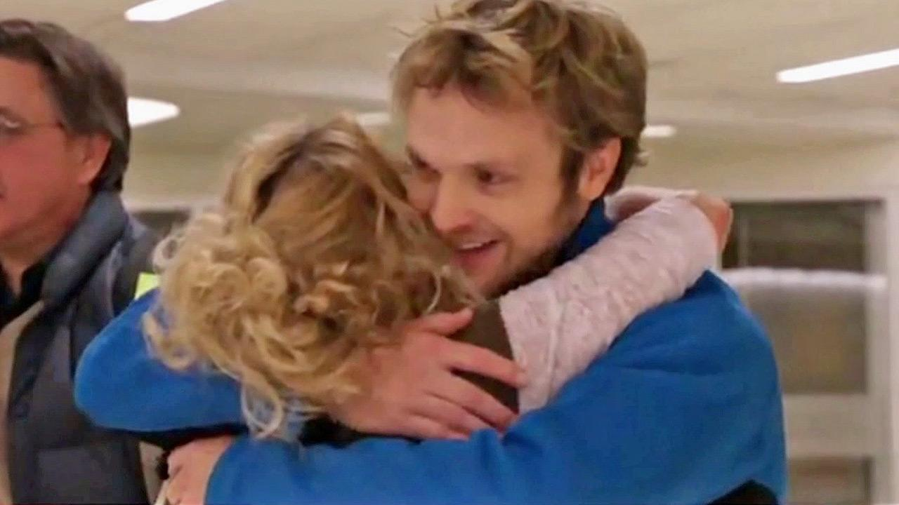 Travis Spire-Sweet is seen hugging his girlfriend at a Kansas hospital.