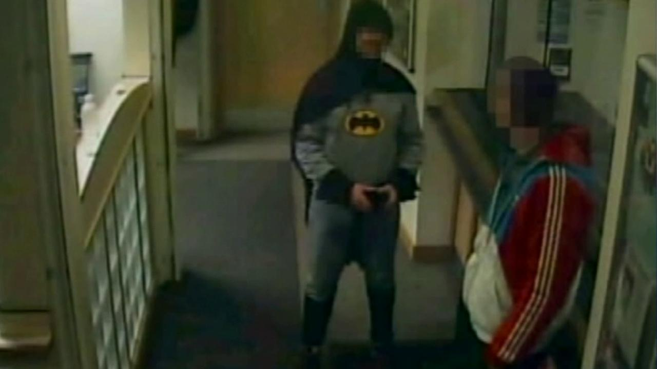 A British man suspected of fraud and handling stolen goods was escorted to a police station by a person dressed up as Batman.