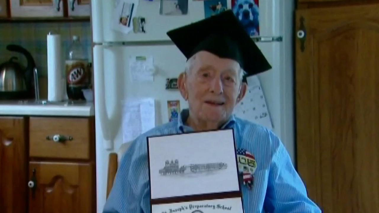 Bill Mohr, 105, is seen holding his high school diploma in this undated photo.