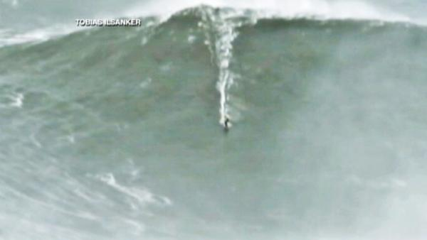 Surfers ride 80-ft waves off Portugal coast