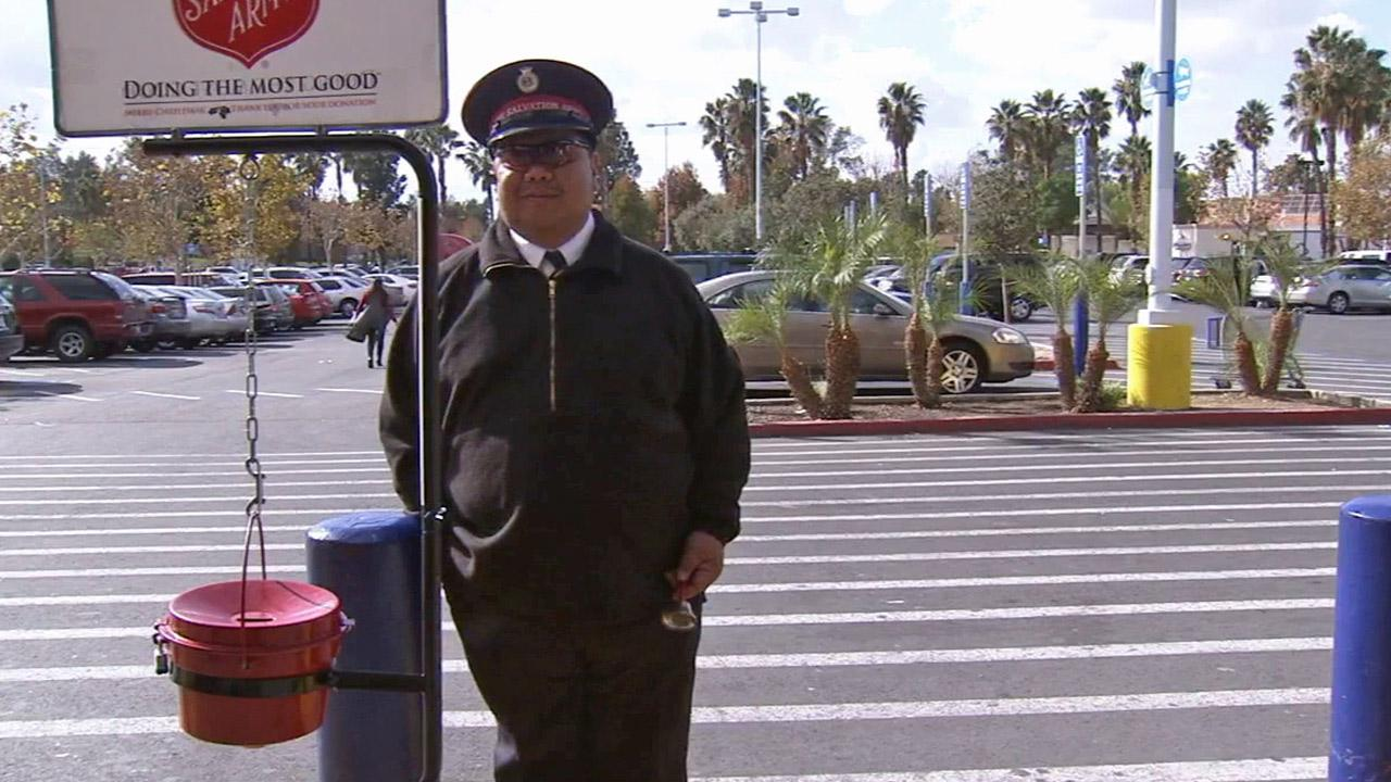 Salvation Army Maj. Butch Soriano is seen ringing a bell outside a store in Colton on Saturday, Dec. 7, 2013.