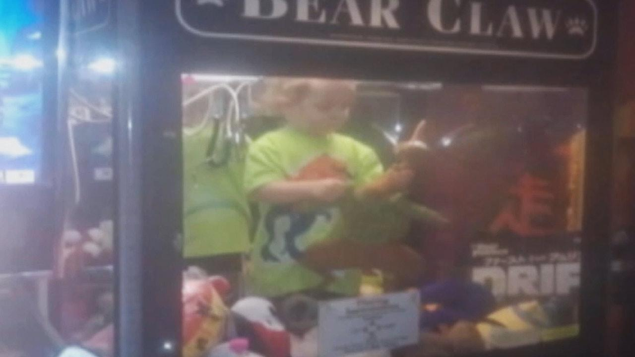 A 3-year-old boy was found happily playing with stuffed animals inside a coin-operated claw-crane machine in Lincoln, Nebraska on Monday, April 14, 2014.