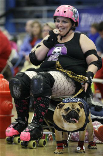 Leanne Sergio, of Ankeny, Iowa, sits with her dog Mya during the 33rd annual Drake Relays Beautiful Bulldog Contest Monday, April 23, 2012, in Des Moines, Iowa.