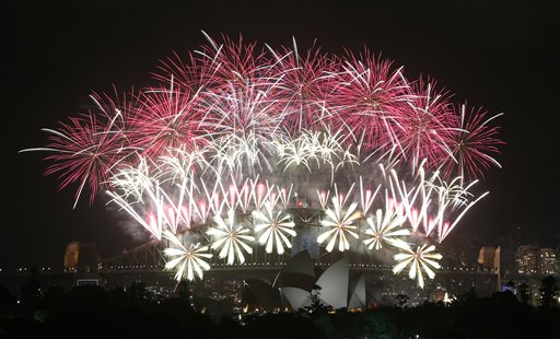 Australia New Years Eve  - Fireworks explode over the Harbour Bridge and the Opera House during New Year&#39;s Eve celebrations in Sydney, Australia, Wednesday, Jan. 1, 2014. <span class=meta>(AP Photo &#47; Rob Griffith)</span>