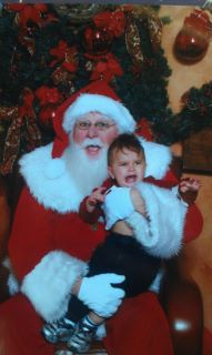 "<div class=""meta ""><span class=""caption-text "">ABC7 viewer Cindy Davis MacArthur posted this photo to the ABC7 Facebook wall of Leighton with Santa Claus.  Post your own photo, and don't forget to tag yourself. Your photo may be used on Eyewitness News! (KABC Photo/ ABC7 viewer Cindy Davis MacArthur)</span></div>"