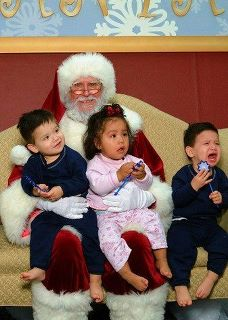 "<div class=""meta ""><span class=""caption-text "">ABC7 viewer Evelia Yacuta Ragsdale posted this photo to the ABC7 Facebook wall of triplets with Santa Claus.  Post your own photo, and don't forget to tag yourself. Your photo may be used on Eyewitness News! (KABC Photo/ ABC7 viewer Evelia Yacuta Ragsdale)</span></div>"