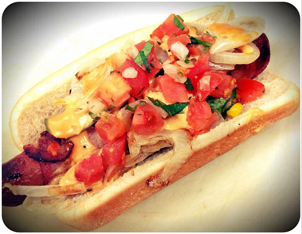 The Los Angeles Angels of Anahiem sells the Halo Street Dog with bacon, sauteed onions and pico de gallo.  <span class=meta>(twitter.com&#47;angels)</span>