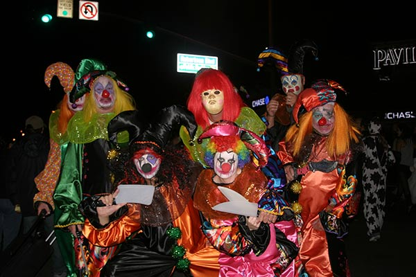 "<div class=""meta ""><span class=""caption-text "">A group dressed as clowns stopped to pose for a photo during the West Hollywood Halloween Costume Carnaval on Thursday, Oct. 31, 2013. (ABC7)</span></div>"