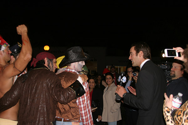 "<div class=""meta ""><span class=""caption-text "">ABC7 Reporter Elex Michaelson interviews a group of people during the West Hollywood Halloween Costume Carnaval on Thursday, Oct. 31, 2013. (ABC7)</span></div>"