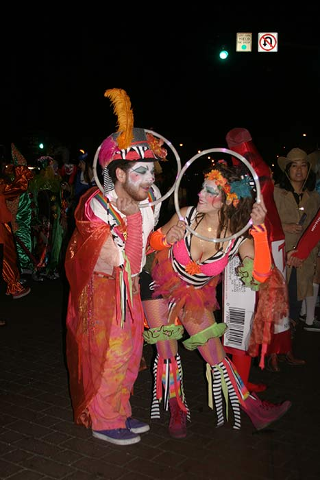 "<div class=""meta ""><span class=""caption-text "">Mike and Elise dressed up as clowns during the West Hollywood Halloween Costume Carnaval on Thursday, Oct. 31, 2013. (ABC7)</span></div>"