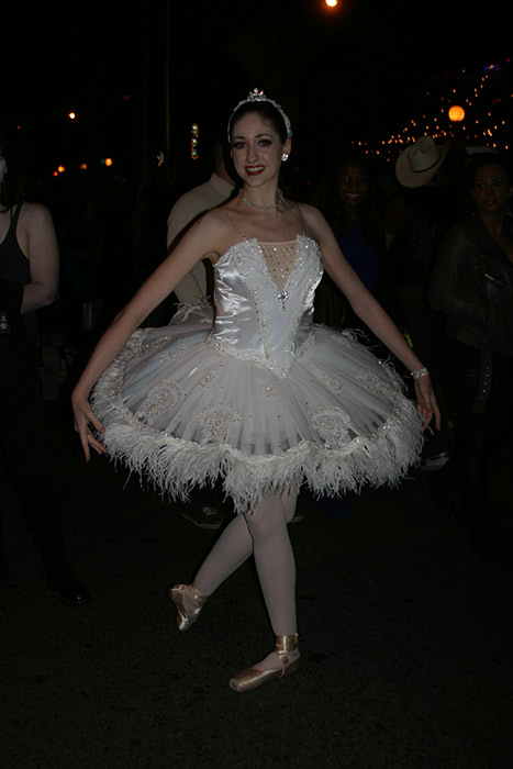 "<div class=""meta ""><span class=""caption-text "">Katie Albin dressed up as a white swan during the West Hollywood Halloween Costume Carnaval on Thursday, Oct. 31, 2013. (ABC7)</span></div>"