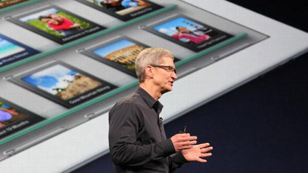 Apple CEO Tim Cook introduces the new iPad during an event in San Francisco, Wednesday, March 7, 2012.