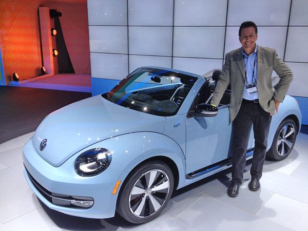 Eyewitness News automotive specialist Dave Kunz with a Volkswagen Beetle on display at the 2012 Los Angeles Auto Show held at the Los Angeles Convention Center downtown on Wednesday, Nov. 28, 2012.