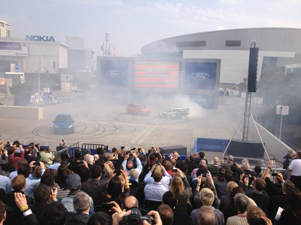 Spectators take in a Ford demonstration at the 2012 Los Angeles Auto Show held at the Los Angeles Convention Center downtown on Wednesday, Nov. 28, 2012.