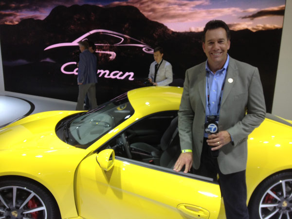 Eyewitness News automotive specialist Dave Kunz with a Porsche on display at the 2012 Los Angeles Auto Show held at the Los Angeles Convention Center downtown on Wednesday, Nov. 28, 2012.