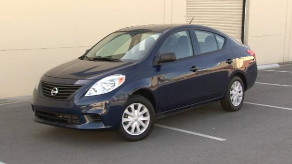 The base model of the Nissan Versa is one of the lowest-priced cars on the market today at just under $11,000. This one with the optional automatic transmission is priced at just over $13,000.