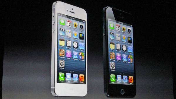 White and black iPhone 5 phones are shown in this photo taken
