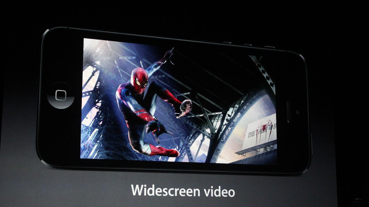 The iPhone 5 features a bigger screen, measuring 4 inches diagonally. A screen shot from a movie is shown in this photo at an Apple event in San Francisco, Wednesday Sept. 12, 2012.Joanna Stern