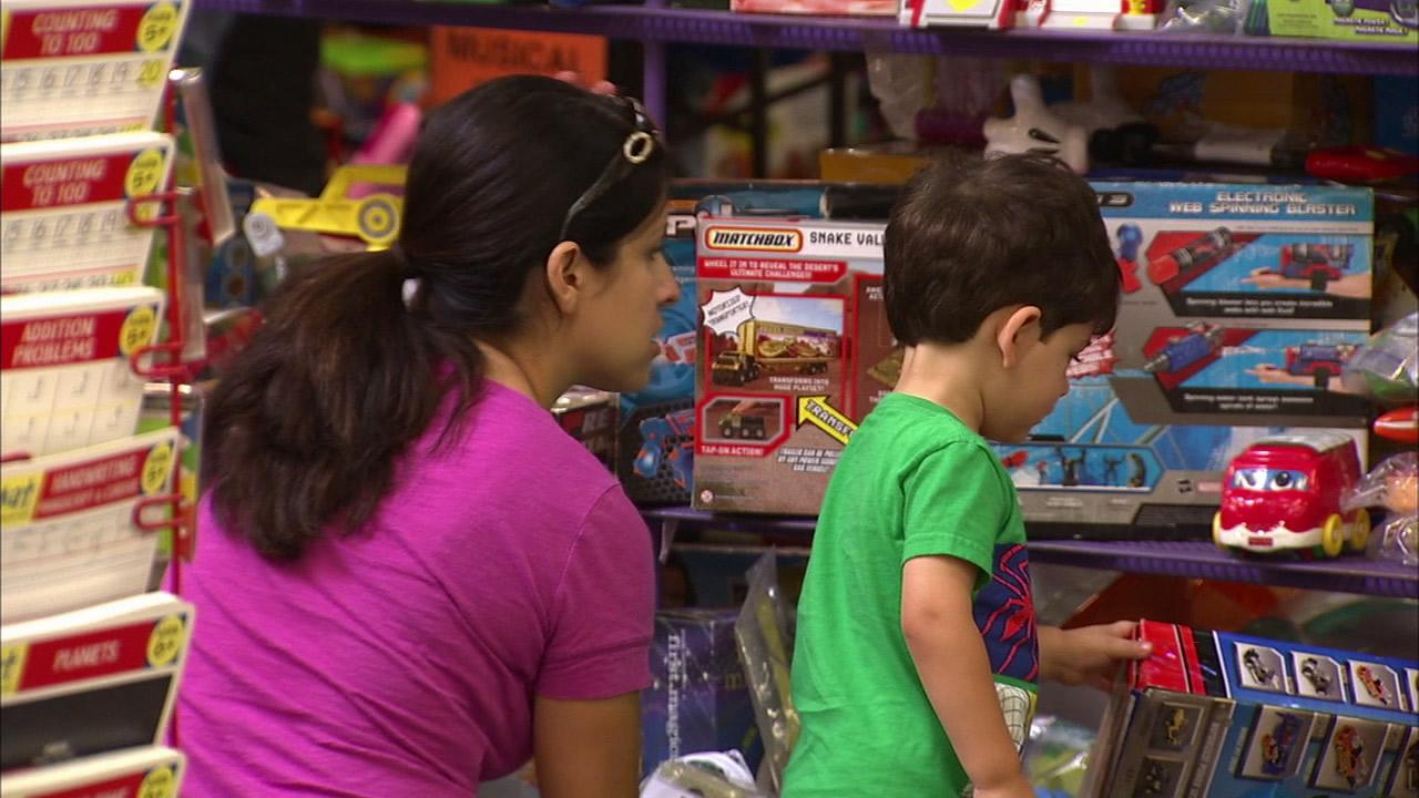 A mom and her son look through toys at the L.A. Kids Consignment in Burbank on Thursday, Sept. 20, 2012.