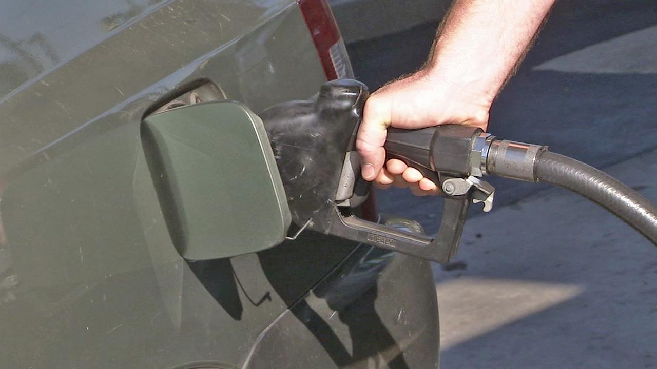 A person pumps gas in this undated file photo.
