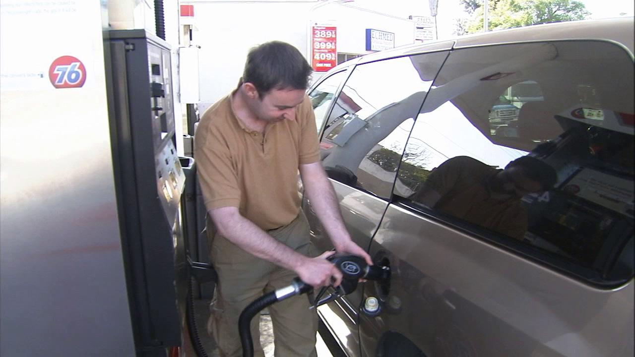 A man is seen pumping gas into his car in this undated file photo.