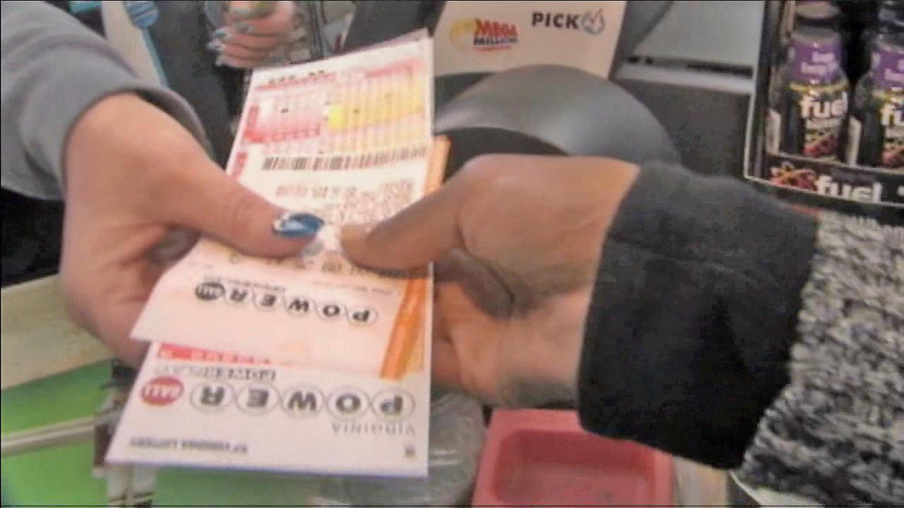 A cashier hands a woman Powerball tickets in this undated file photo.