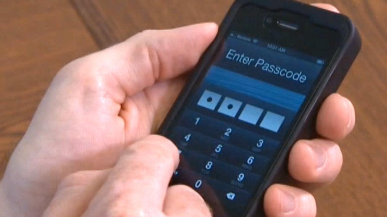 File photo of an iPhone passcode security screen.