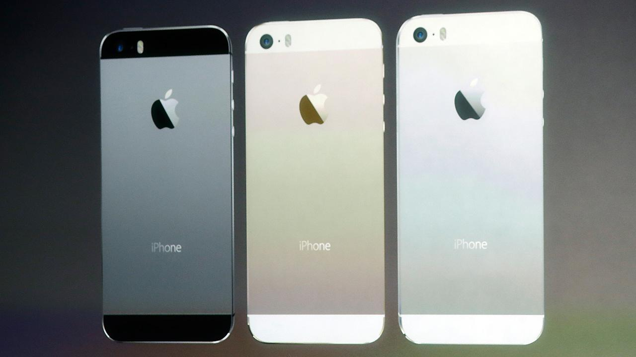 Apple reveals the iPhone 5S, which comes in gold, silver and space gray, on Tuesday, Sept. 10, 2013.
