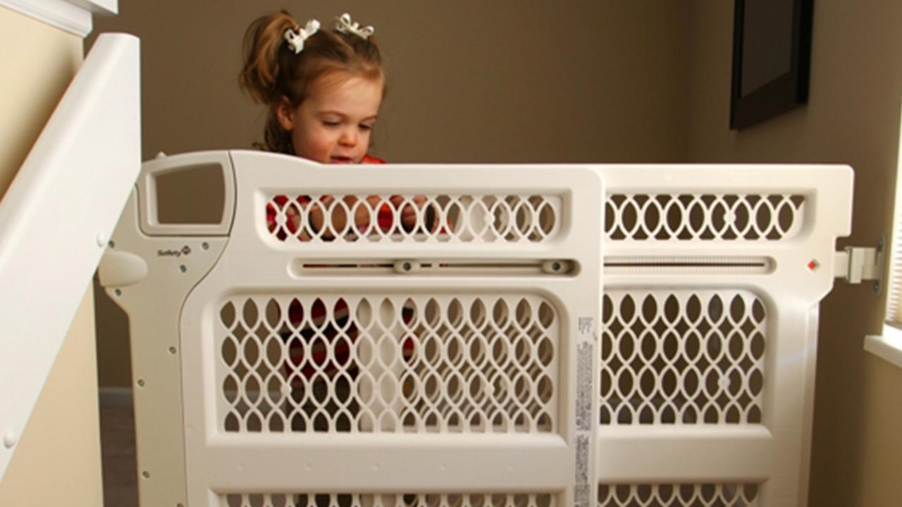 A child stands behind a baby gate in this undated file photo.