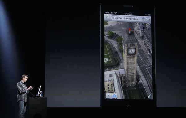Scott Forstall, Apple's senior vice president of iOS Software, shows features on the iPhone 5 during an Apple event in San Francisco, Wednesday, Sept. 12, 2012.