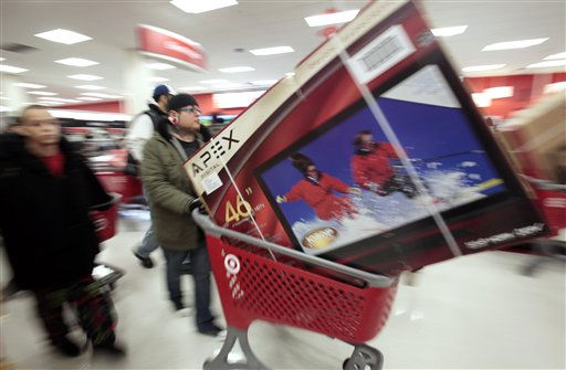 "<div class=""meta image-caption""><div class=""origin-logo origin-image ""><span></span></div><span class=""caption-text"">Shoppers take advantage of Black Friday sales in the early morning at a Target store Friday, Nov. 26, 2010 in Chicago. The store opened at 4 a.m. on Friday.  (AP Photo/ Kiichiro Sato)</span></div>"