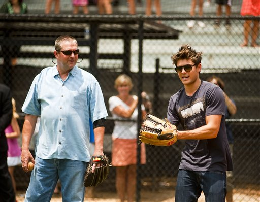 In this publicity image released by Allied Integrated Marketing, actor Zac Efron prepares to throw the ball as Atlanta Braves pitching coach Roger McDowell, left, looks on during an appearance by Efron to promote his new film &#39;Charlie St. Cloud&#39; at the Dan Perez Baseball Camp at Murphey Candler Baseball Park on Tuesday, July 13, 2010, in Atlanta.  <span class=meta>(Allied Integrated Marketing, Pouya Dianat)</span>