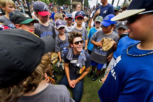 In this publicity image released by Allied Integrated Marketing, fans gather to meet actor Zac Efron as he promotes his new film &#39;Charlie St. Cloud&#39; at the Dan Perez Baseball Camp at Murphey Candler Baseball Park on Tuesday, July 13, 2010, in Atlanta. <span class=meta>(Allied Integrated Marketing, Pouya Dianat)</span>