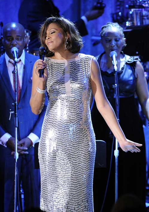 In this Feb. 13, 2011 file photo, singer Whitney Houston performs at the pre-Grammy gala & salute to industry icons with Clive Davis honoring David Geffen in Beverly Hills, Calif. Her publicist confirmed her death Saturday, Feb. 11, 2012. Houston was 48.