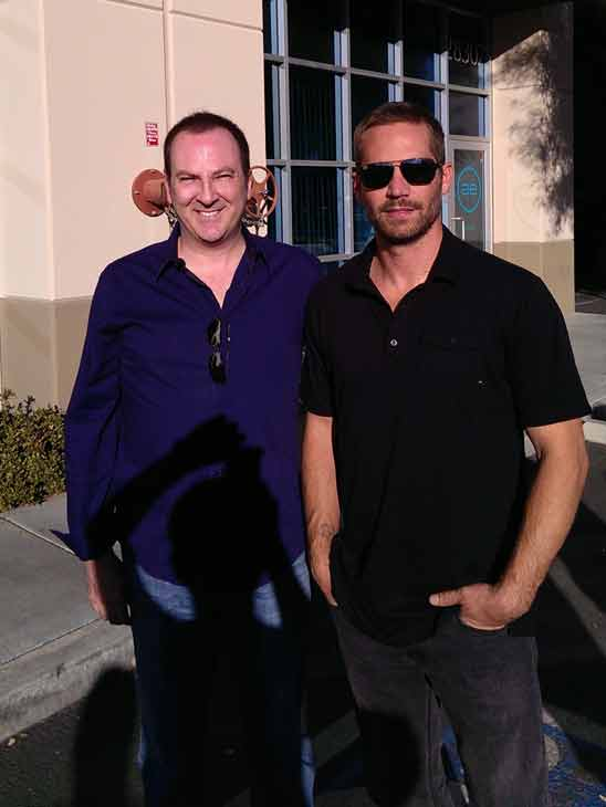 Actor Paul Walker appears with Bill Townsend, CEO and founder of PacAirVentures, at an automotive gathering and toy drive in Valencia Saturday, Nov. 30, 2013. Walker and his friend, Roger Rodas, died in a single-vehicle crash following the event.