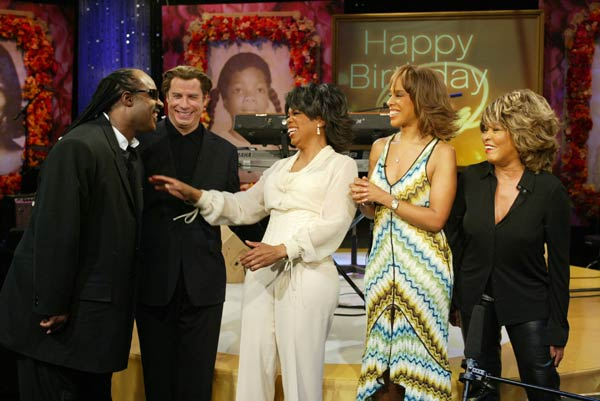 Stevie Wonder, John Travolta, Gayle King and Tina Turner appear on 'The Oprah Winfrey Show' on Winfrey's 50th birthday. An estimated average of 40 million Americans view 'The Oprah Winfrey Show' each week.