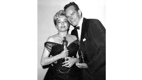 Simone Signoret and Charlton Heston
