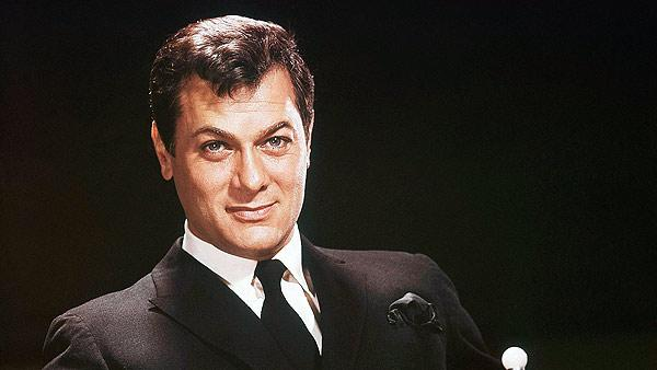 Actor Tony Curtis is shown seated in a studio chair, 1965 file photo. Curtis died Wednesday Sept. 29, 2010 at his Las Vegas area home of a cardiac arrest at 85 according to the Clark County, Nev. coroner.