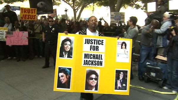 Michael Jackson fans stand outside the downtown Los Angeles courtroom where the pop singer's doctor, Conrad Murray, was convicted of involuntary manslaughter in Jackson's death on Monday, Nov. 7, 2011.