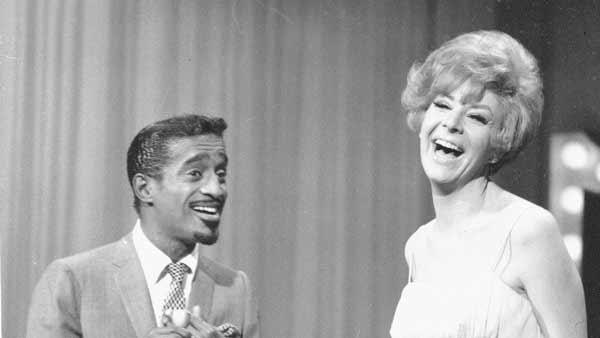 Sammy Davis Jr. and Kaye Stevens perform on a TV show, on January 6, 1967.