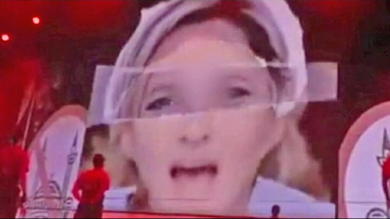 A still from footage of a July 2012 Madonna concert shows National Front party leader, Marine Le Pen, on-screen. Le Pen was shown with a swastika on her forehead during Madonnas live performance, although the symbol has been blurred out of this image.