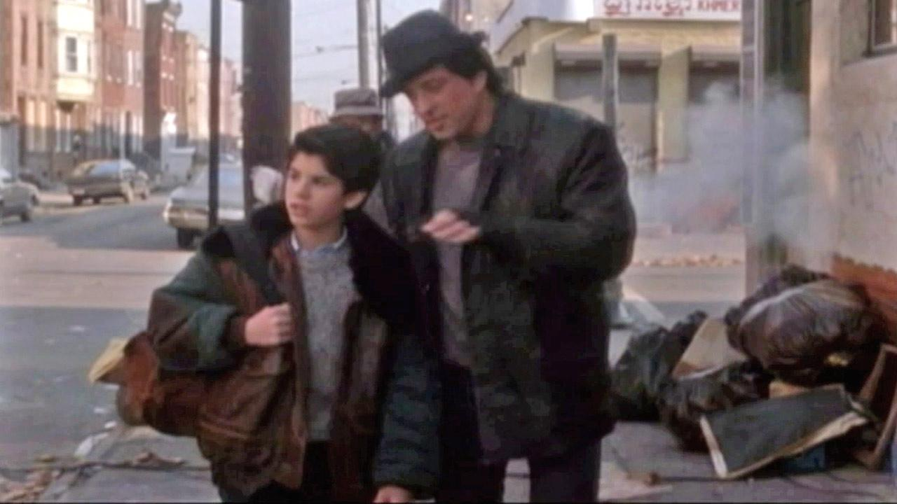Sylvester Stallone (right) walks with son Sage Stallone (left) in a scene from the 1990 film Rocky V.