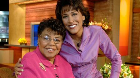 This 2006 photo shows Good Morning America co-host Robin Roberts, right, with her mother Lucimarian Roberts on the set in New York.