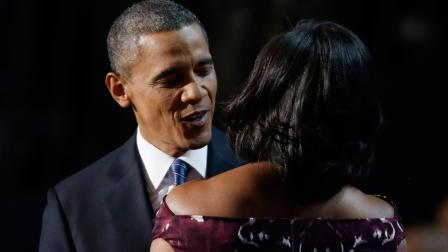 President Barack Obama hugs his wife First lady Michelle Obama at the Democratic National Convention in Charlotte, N.C., on Thursday, Sept. 6, 2012.