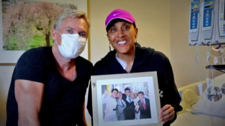 Good Morning America weather anchor Sam Champion and Good Morning America co-anchor Robin Roberts pose in this September 2012 photo.